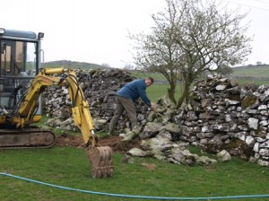 Removing stone wall to start pump house