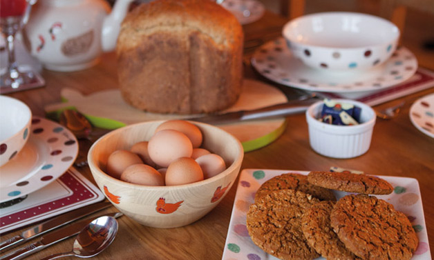 Welcome pack including milk, locally baked biscuits, home baked bread and free range eggs