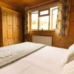 Hipley log cabin master bedroom