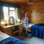 Hipley log cabin accessible bedroom