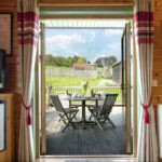 Rainster french doors onto decking
