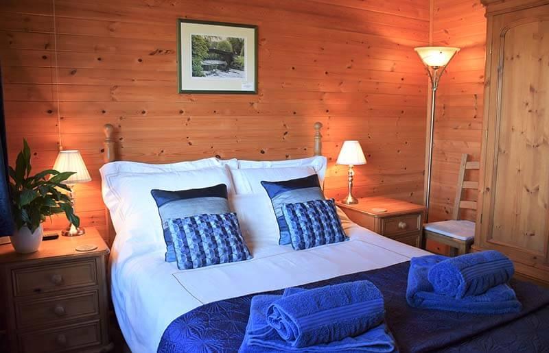 Pinder log cabin master bedroom