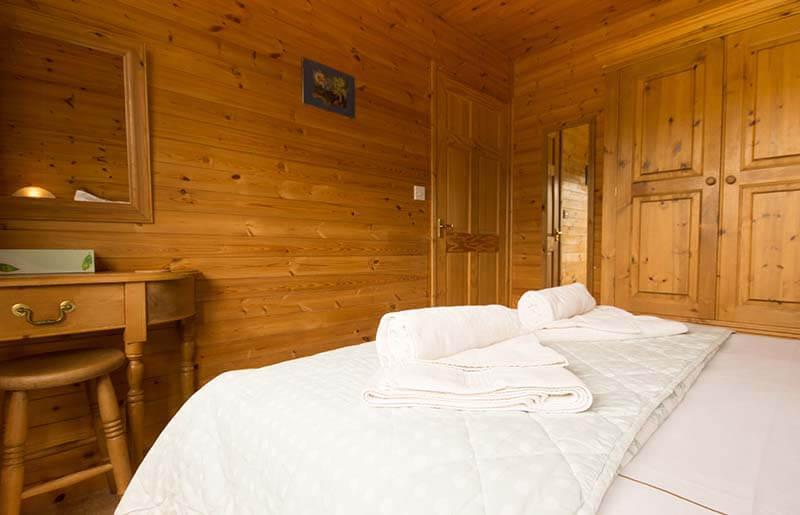 Pinder log cabin double bedroom