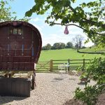 Gypsy Caravan Holidays with a farm view