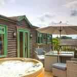 Pinder log cabin hot tub on decking