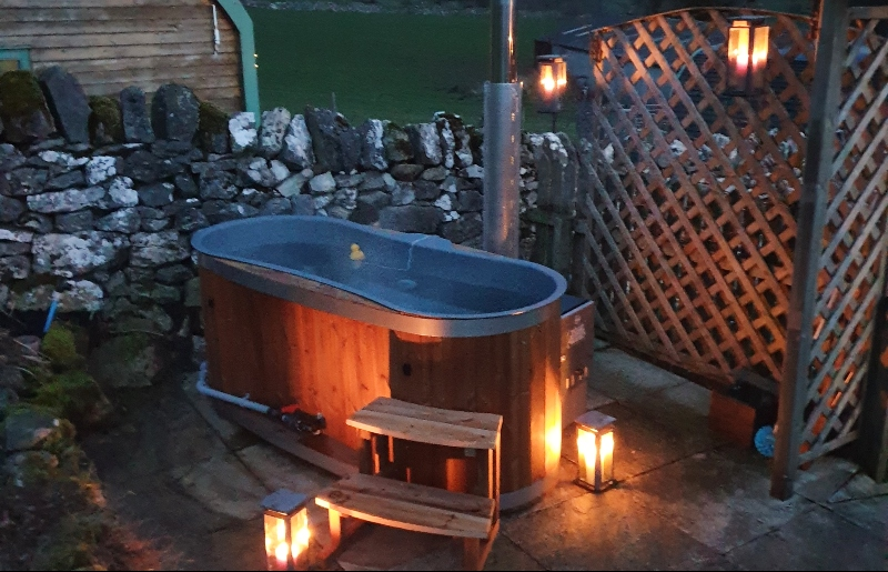 Log fired hot tub